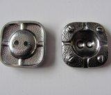 Zilverkleurige bewerkte knoop 2,5 cm_